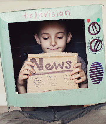 Child Reading the News